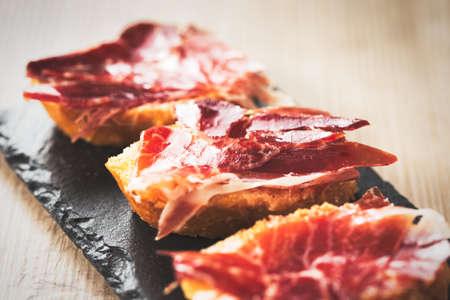 Jamon iberico, the best spanish ham tapas. Vintage food edition.