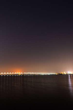 River bridge nightscape with road lights. Night cityscape.
