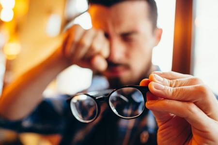 Photo pour Closeup portrait of young man with glasses, who has eyesight problems - image libre de droit