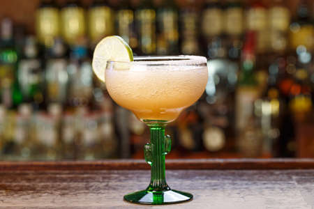 Margarita is a cocktail with tequila, with lime or lemon juice, citrus liqueur - triple-sec, and ice. It is classified as a cocktail for the whole day.