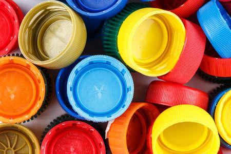 Photo pour many plastic covers of different colors scattered - image libre de droit