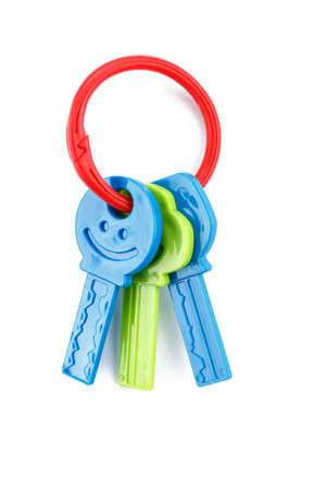 Foto de plastic toy keys isolated, colorful teethers for babies  - Imagen libre de derechos