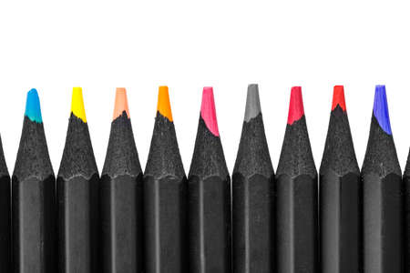 Foto de Multi-colored pencils on a white background laid out in a row. isolated - Imagen libre de derechos