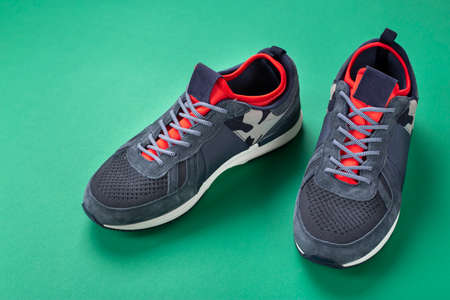 Photo pour men's sneakers on a bright green background. place for text. casual shoes for fall - image libre de droit