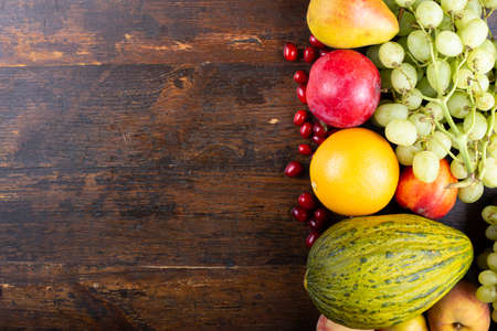 Photo for different fresh fruit set. on a wooden brown background. place for text  - Royalty Free Image