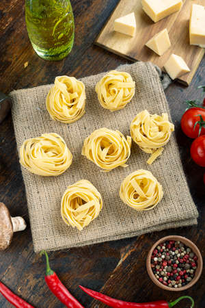 Italian rolled fresh fettuccine pasta. Italian food concept. Ingredients for making pasta. Space for ext.