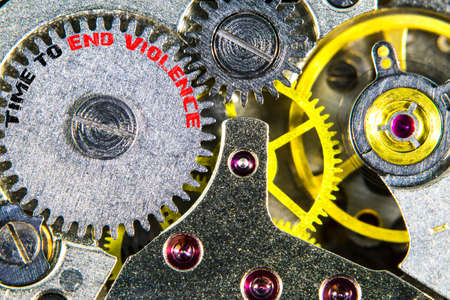 The clockwork old mechanical  high resolution with words Time to End Violence