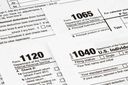 Photo pour The tax forms with  money and the pen. Tax Day concept. - image libre de droit