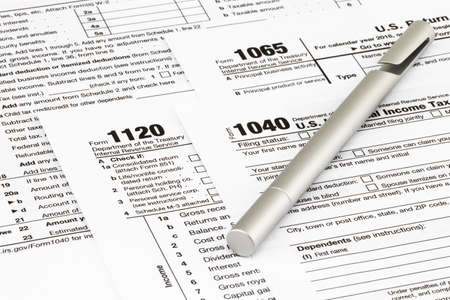 The tax forms with  money and the pen. Tax Day concept.