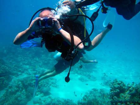 Photo pour Man scuba diver and beautiful colorful coral reef underwater. - image libre de droit
