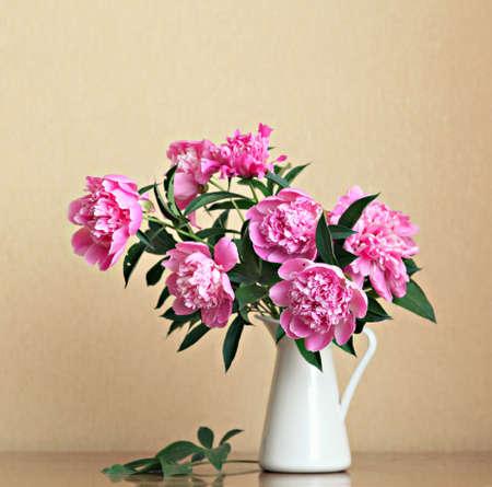 Bouquet of peonies blooms in vase