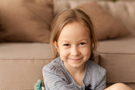Photo for Portrait of a seven year old girl at home - Royalty Free Image