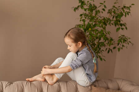 Photo for Girl examines her legs at home - Royalty Free Image