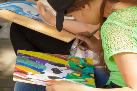 Pyatigorsk, Russia - June 1, 2014  Children s Day  Young artists behind work  competition of children s drawing