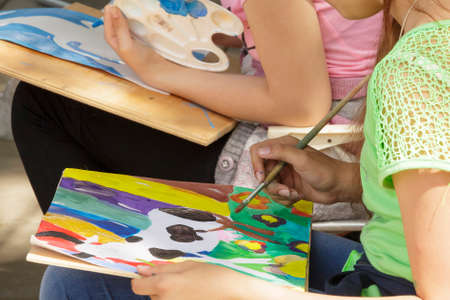 Pyatigorsk, Russia - June 1, 2014  Children s Day  The young artist behind work  competition of children s drawing