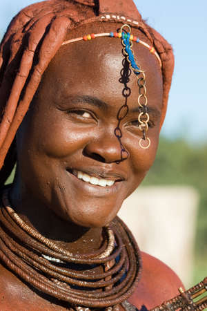 Himba woman portrait on blue sky background