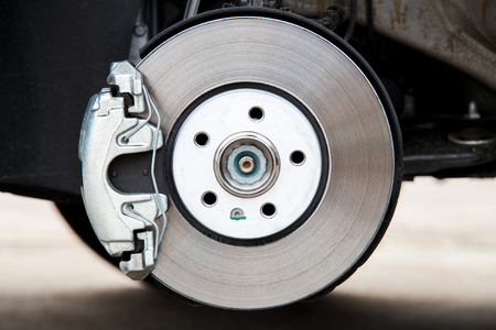 Photo pour Car brake system. New brake caliper. New brake disk. - image libre de droit