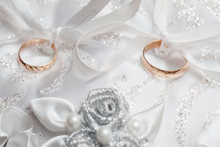 Wedding gold rings on a white pillow