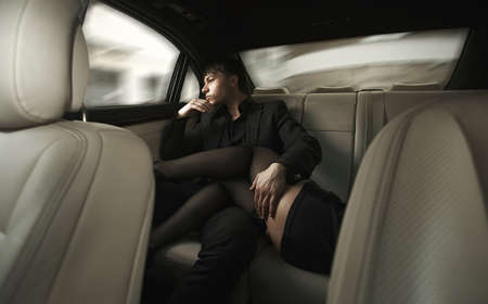 Photo for Adult sexy man sitting in car with girl - Royalty Free Image