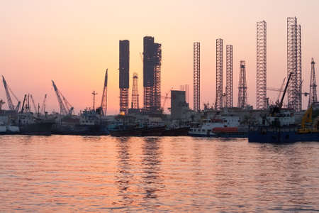 Oil rigs at sunset. Sharjah. United Arab Emirates