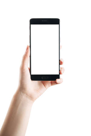 Photo for woman hand holds smartphone isolated on white background, with a clean screen - Royalty Free Image