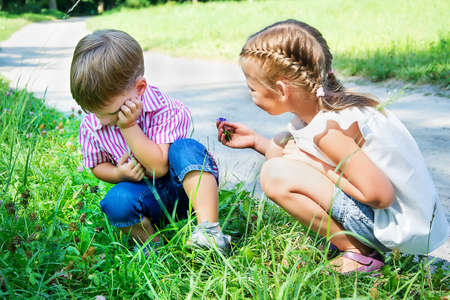 Photo for little girl apologizes to offended boy - Royalty Free Image