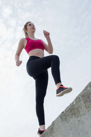 Foto per Sporty girl doing push-ups outdoors. Young woman in sportswear training on open air - Immagine Royalty Free