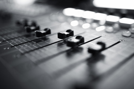 Photo for Professional audio mixing console with faders and adjusting knobs,TV equipment Black and White selective focus - Royalty Free Image