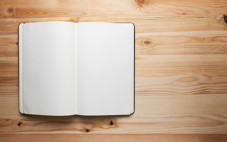 Photo pour open book with blank pages on wood table,Notebook on wood table for background space for text - image libre de droit