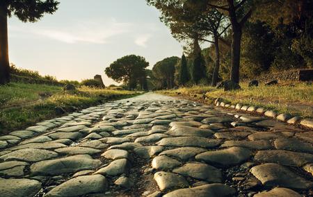 Photo pour Antique road , Via Appia Antica in Rome, Italy on sunset - image libre de droit