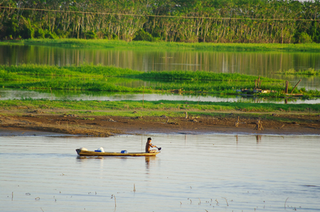 MANAUS,BR - CIRCA AUGUST 2011 - Fisherman on a canoe on the Amazon river. Fishing is part of the economy of the region.