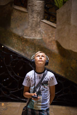 Young boy visit La Pedrera with audioguide. Additional education.