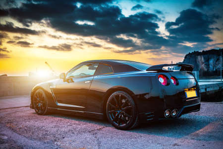 Photo pour SISTIANA, ITALY JUNE 12, 2013: Photo of a Nissan GT-R Black Edition. The Nissan GT-R is a 2-door 2+2 sports car produced by Nissan and unveiled in 2007. - image libre de droit