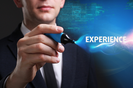 Business, Technology, Internet and network concept. Young businessman working on a virtual screen of the future and sees the inscription: Experience