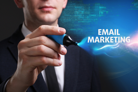 Business, Technology, Internet and network concept. Young businessman working on a virtual screen of the future and sees the inscription: Email marketing