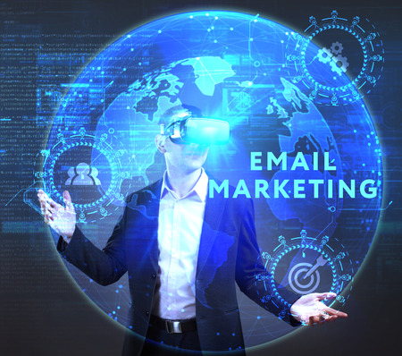 The concept of business, technology, the Internet and the network. A young entrepreneur working on a virtual screen of the future and sees the inscription: Email marketing