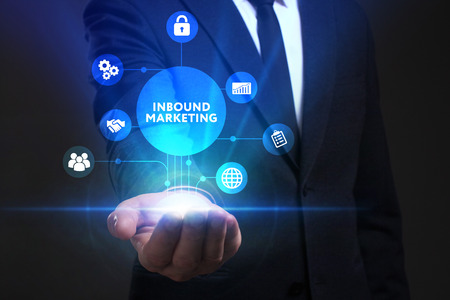 Business, Technology, Internet and network concept. Young businessman working on a virtual screen of the future and sees the inscription: Inbound marketing