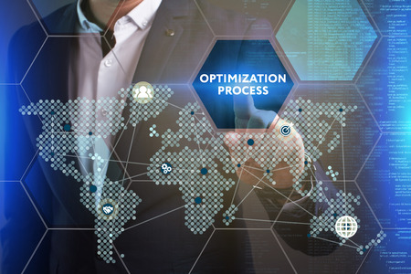 Business, Technology, Internet and network concept. Young businessman working on a virtual screen of the future and sees the inscription: Optimization process