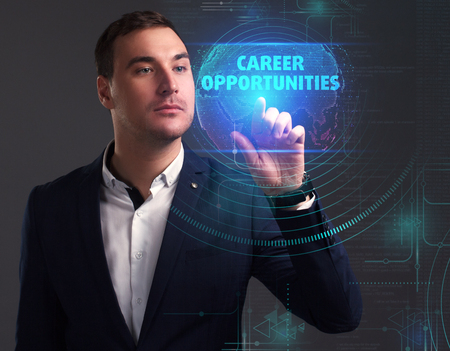 Business, Technology, Internet and network concept. Young businessman working on a virtual screen of the future and sees the inscription: Career opportunities