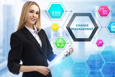 Photo pour The concept of business, technology, the Internet and the network. A young entrepreneur working on a virtual screen of the future and sees the inscription: Change management - image libre de droit