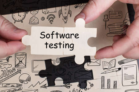 Photo pour Business, Technology, Internet and network concept. Young businessman working on a virtual screen of the future and sees the inscription: Software testing - image libre de droit