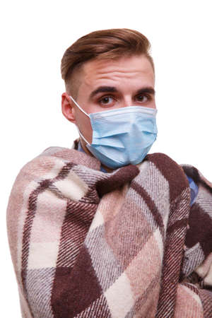 Sick guy in medical mask close-up on white isolated background