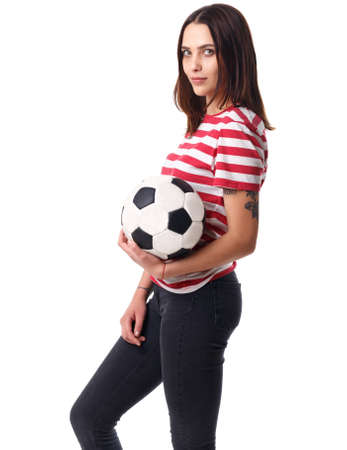 Girl stands sideways holding the ball on a white isolated background