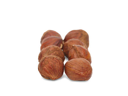 A bunch of useful kernel hazelnuts in the shell are laid out exactly in two rows. Close-up. Isolated on white background.