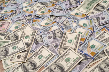 Photo pour Background of 100 new and old dollar bills - image libre de droit