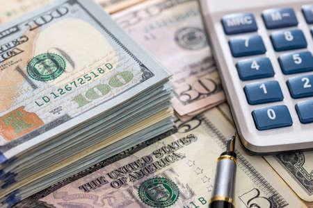 Photo pour us dollar with pen and calculator close up. - image libre de droit