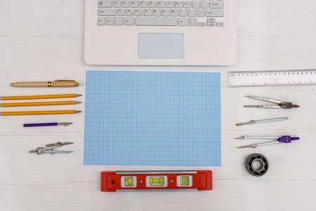 Photo pour Draftsmanship equipment for drawing on millimeter paper with laptop - image libre de droit