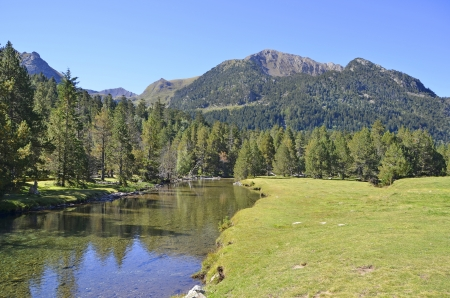 Tranquil scene in Aiguestortes i Stany de Sant Maurici National Park. Vall d'Aran, Lleida, Catalonia, Spain