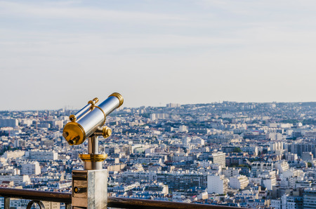 Tourist telescope in the Eiffel tower for view the city of Paris
