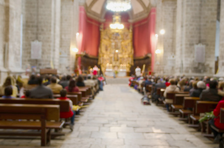 Photo for Blurred picture of a mass in a catholic cathedral. Christian ceremony of the sacred mass - Royalty Free Image